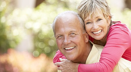 A smiling couple with beautiful teeth, thanks to dental crowns in Salinas, CA