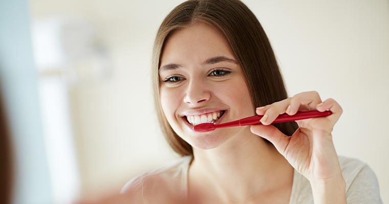 Young girl practicing oral hygiene during COVID-19