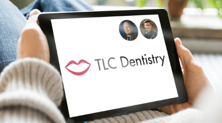 iPad with TLC Dentistry's logo and doctors' pictures for the virtual consultation